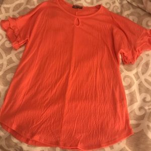 Boutique top with ruffle sleeves